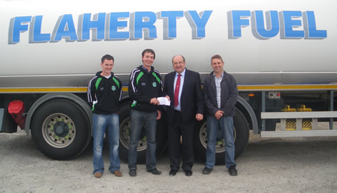 John Mollen (Senior Football Captain) Aidan Doyle (Club Chairman) receiving sponsorship from Brendan Flaherty and David Flaherty