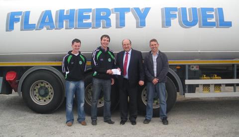 John Mollen (Senior Football Captain) Aidan Doyle (Club Chairman) receiving sponsorship from Brendan Flaherty and David Flaherty